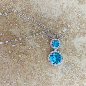 Aquamarine cz silver colored necklace